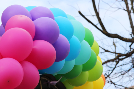 Multicolored balloons adorn the entrance to the cafe Stock Photo - 77583235