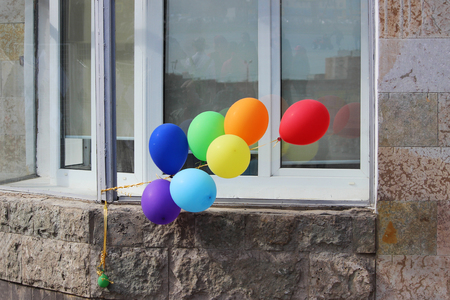 Multicolored balloons adorn the entrance to the cafe.