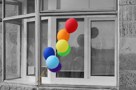 Multicolored balloons adorn the entrance to the cafe On a black and white background Stock Photo - 78517275