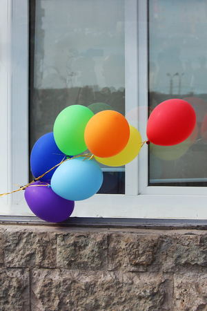 Multicolored balloons adorn the entrance to the cafe. Stock Photo - 78527038