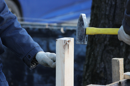 Workers mount the formwork for pouring concrete and tiling. Stock Photo