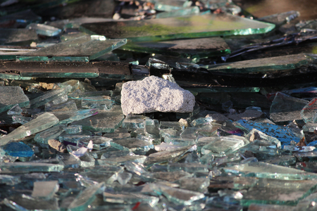 Vandals smashed the glass windows of the unfinished unguarded abandoned building of the shopping complex.