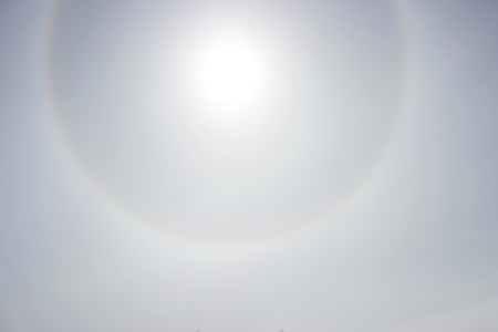 Halo a rainbow around the sun in the afternoon before the weather worsens