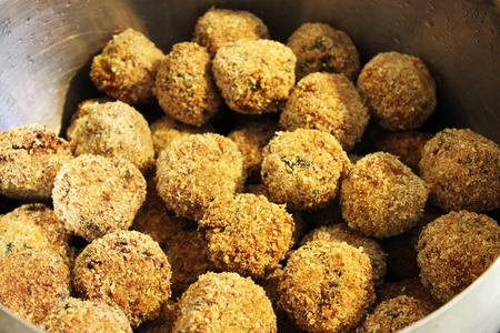 Falafel - a dish of deep-fried balls from chopped chickpeas, with the addition of beans, seasoned with spices.
