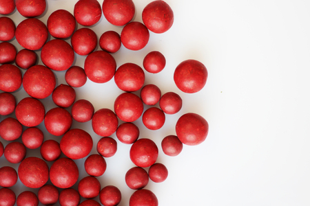 globule: Macro photo of many red ball-shaped pills. Tibetan folk medicine from the herbal complex. Stock Photo