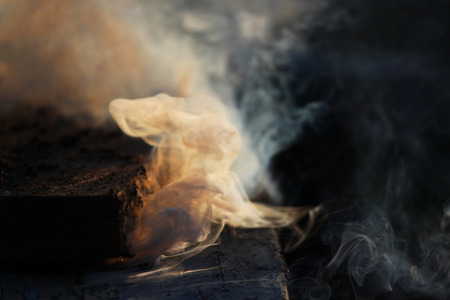 daydream: White smoke from the fire where wet boards and sawdust lie.