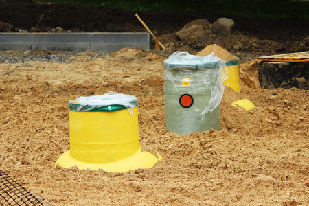 Plastic tank gas oil catcher in the ground during the construction of a car park for tourist buses, Russia.