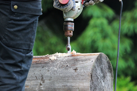 borax: Metal spiral drill for making holes in logs when assembling a wooden frame and building a house.