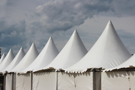 high section: Festival white big tents near the park on holiday Stock Photo