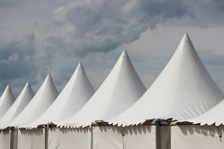 Festival white big tents near the park on holiday Stock Photo