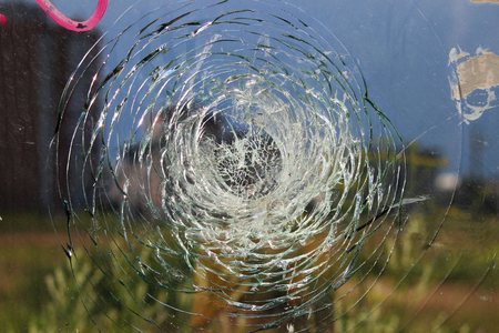 vandalism: Vandals smashed the glass at a bus stop in the city. Stock Photo