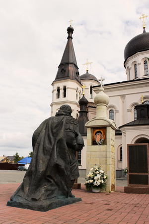 Sculpture kneeling figure of the Holy Prince Alexander Nevsky near the church of the Holy Equal-to-the-Apostles Constantine and Helena. Russia.