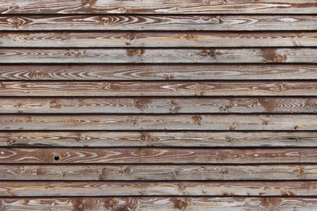 texture of a brown wooden fence of plaques covered with paint. Banco de Imagens