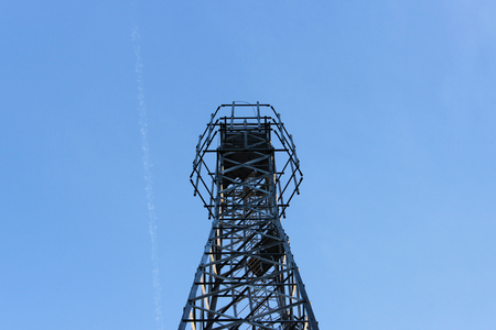 Large tower of metal structures against the blue sky. Metal construction