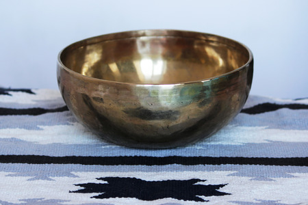One singing Tibetan brass bowl for relaxation and meditation Stock fotó