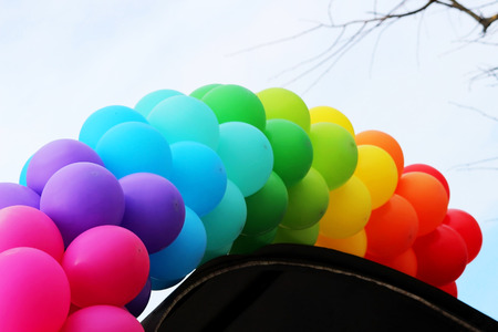 Many colorful air balloon like rainbow adorn the entrance to the cafe at its opening