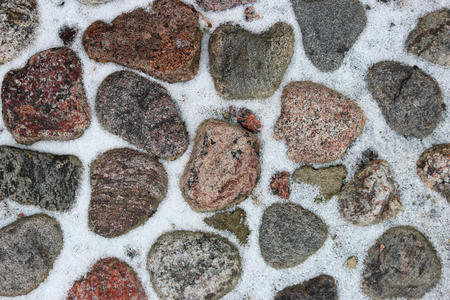 historical cobblestone pavement with white snow at the Gatchina, in the winter. Russia. Stock Photo
