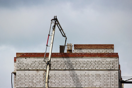 solution to a brick building under construction when the concrete mixture is poured