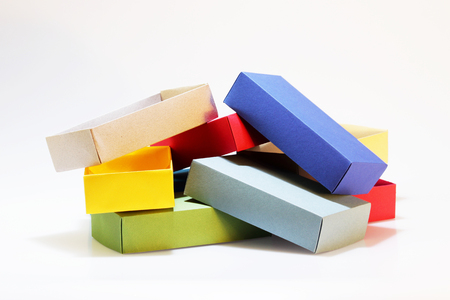 Few colorful paper boxes of colored cardboard for packing bow ties and other gifts on a white background. Hand made