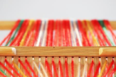 Weaving mini machine for making belts with patterns. Folk art, handmade. Detail Standard-Bild - 93018487