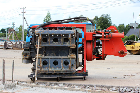 Vibrator pile driving Machine or vibro hammer stands on the site of construction of a major road junction. Russia