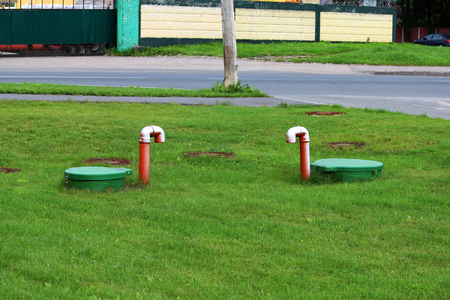 Tube of plastic tank gas oil catcher in the ground on the territory of the gas station, Russia.