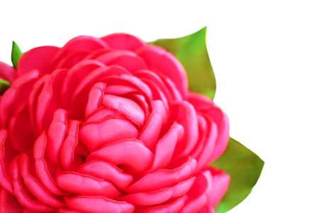 flower artificial handmade pink rose from satiny ribbons on white background, isolated.