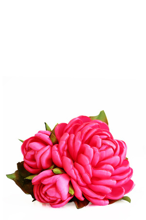 flower artificial handmade pink rose from satiny ribbons with buds on white background, isolated. vertical photo