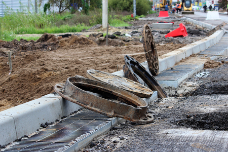 capital repair of the road on the outskirts of the city and preparation for the installation of hatches and gutters.