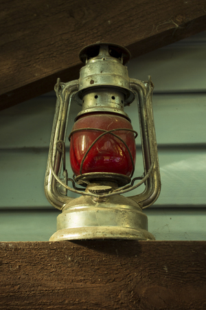 old red Soviet kerosene lamp, which was hung on the last carriage of a freight train. rarity. Russia Stock Photo