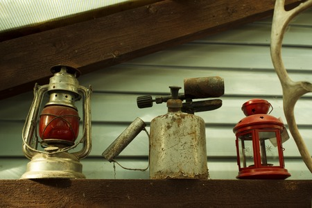 old red Soviet kerosene lamp, which was hung on the last carriage of a freight train, blowtorch, candlestick and a piece of antler - an interior in a country house. rarity. Russia