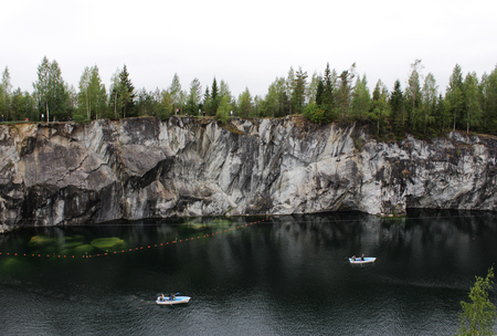 Ruskeala marble quarry, Karelia, Russia. turquoise water in the river and gray with white veins of the shore, forest