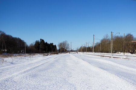 Railway after snowfall in winter with sleepers covered with snow. Stock Photo