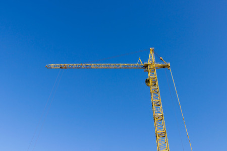 Crane on the background of the sky working in the city Stock Photo