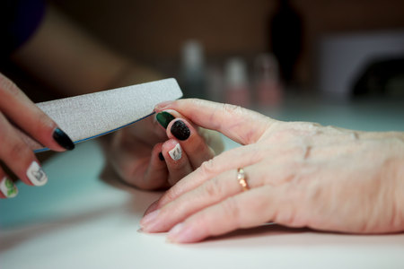 manicure for an elderly woman. the beauty of old age. age skin.