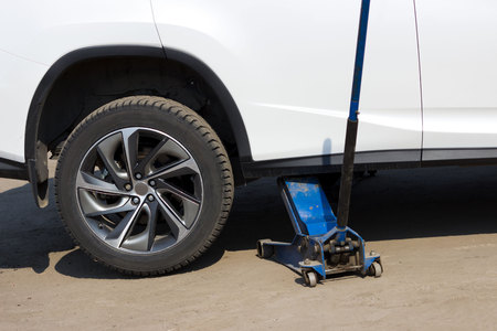 spring tire fitting. Replacing studded wheels with ordinary ones. The jack on the other hand lifts the car and the wheel is removed there