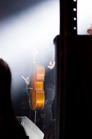 man musician with a cello on the stage. reportage.