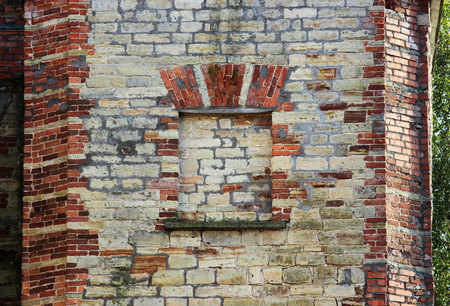 A fragment of an old brick and limestone historical building. Gatchina. Russia