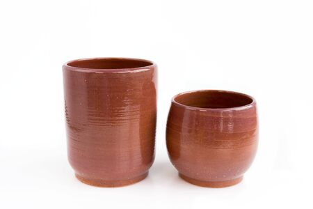 two decorative clay vases. Made by hand on a potters wheel. In a single copy. On white background. Handmade, OOAK. Set