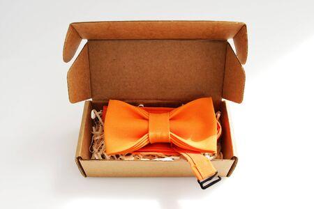bow tie in a cardboard gift box. color orange Reklamní fotografie