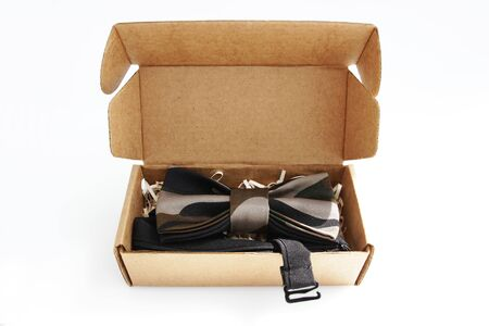 bow tie in a cardboard gift box. color khaki.