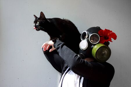 girl in gas mask with black cat. The Cat Lady. cosplay