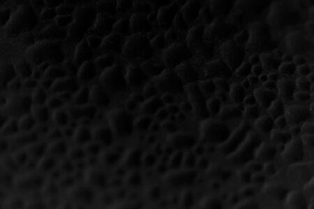 black velvet droplet background. computer processing, inversion darkness