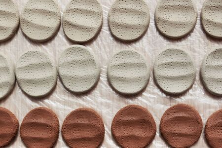 clay samplers dry. Spanish stone masses in the form of round pellets for testing glazes.