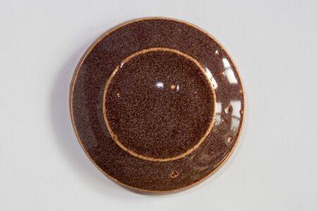 round clay probe with brown glossy glaze