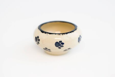 small children's dish with cat footprints. mini pot. author ceramics, all in one copy Banque d'images