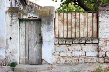 wooden door and old fence in a rustic house. village life textures Stok Fotoğraf