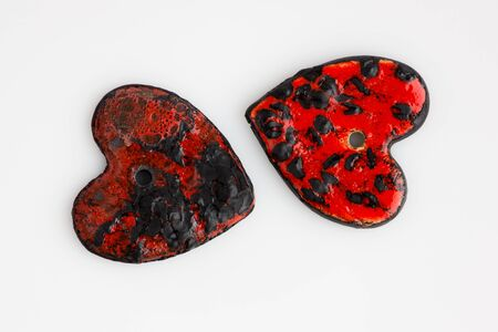 two black and red ceramic heart. two glazes, handmade, ooak. 写真素材