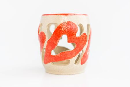 ceramic candlestick with heart decor on white background. original pottery for valentines day Stok Fotoğraf
