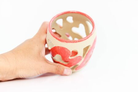 ceramic candlestick with heart decor on white background. original pottery for valentines day Banque d'images